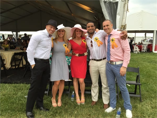 Residents enjoying the Preakness at the Pimlico Race Course in Baltimore, Maryland.