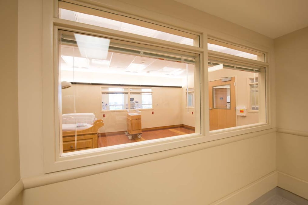 Babies in the nursery can be seen through the viewing window in the hallway.